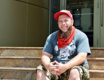 Nathan McKay, one of Justin Bieber's earliest friends and mentors, sits on the steps to the Avon Theatre in Stratford – the very same steps on which the pop star began his musical career. Galen Simmons/The Beacon Herald/Postmedia Network