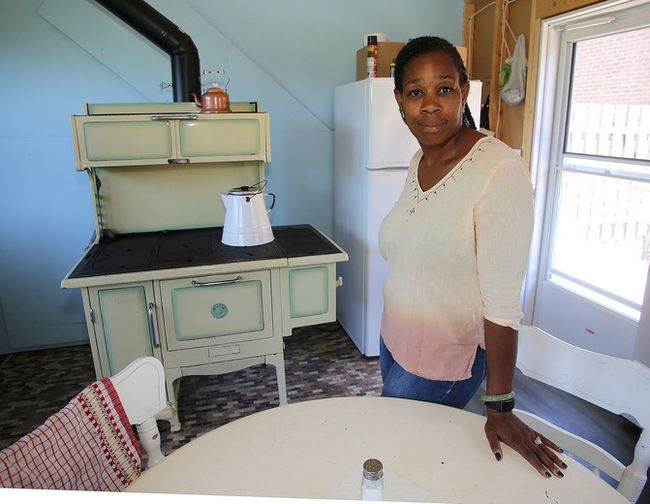 Tina Bobb inside of her summer kitchen in Kingston on Monday July 9 2018 where the wood stove inside when being used sends smoke into a neighbour's home   Ian MacAlpine/The Whig-Standard/Postmedia Network