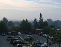A smoky haze could be seen across Timmins Thursday morning. This is a photo from Cedar Street North looking towards the Timmins and District Hospital at about 8 a.m. The outline of the hospital building, left centre, can barely be seen.