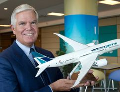 Gregg Saretsky, who was president and CEO of WestJet between 2010 and March 2018, holds a model of the Boeing 787 Dreamliner at the company's annual general meeting in Calgary, Alta. on Tuesday, May 2, 2017. Larry MacDougal/The Canadian Press