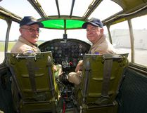Pilot Richard Petty and pilot and Operations officer Travis Major after flying a WWII Mitchell B-25 bomber over Sarnia as part of a tour by the Commemorative Air Force on Thursday July 12, 2018. The B-25 was made famous by the Doolittle Raid, early in WWII after the U.S. was hit by the Japanese at Pearl Harbour, 16 B-25's launched off an aircraft carrier and bombed Tokyo and then ditched their planes in China. Mike Hensen/The London Free Press/Postmedia Network