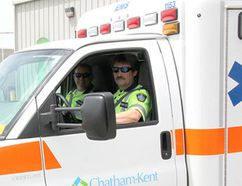 Medavie paramedics Mark Martin, in the driver's seat, and Steve Forbes are shown outside of Chatham-Kent EMS headquarters last year. File photo/Postmedia Network