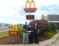(L-R): Owner Rob Reid, scholarship recipient Tatiana Trebish and Manager Rodney Walduck outside McDonald's in Goderich. (Kathleen Smith/Goderich Signal Star)