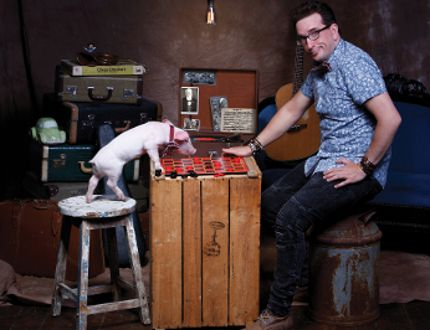 Country musician Scotty Kipfer and Peter Porker, the pig he rescued from the side of the road on his way back to Ontario from Calgary earlier this year, appear on the cover of Kipfer's debut album, Taking My Time. (Photo by Scotty Kipfer)