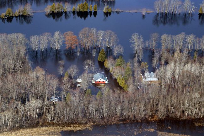 Luke Hendry/The Intelligencer Flood water surrounds a home near Tweed in April of 2014. Increased flooding, freezing rain storms, more hot days and shorter winters are part of the future forecast for southern Ontario, the result of climate change, climate experts say.