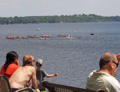Residents of Sudbury watch at Memorial Park on Saturday as dragon boat teams race back and forth on Ramsey Lake to raise money for a local charity. Julia Lloyd/For The Sudbury Star