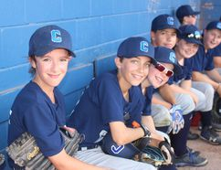 The Cornwall River Rats majors team members were all smiles in the dugout before Saturday's playdown game against Kingston. Todd Hambleton/Cornwall Standard-Freeholder