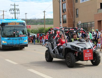 A parade monitor and municipal transit bus follows the Canada Day Parade in Fort McMurray, Alta. on July 1, 2018. Vincent McDermott/Fort McMurray Today/Postmedia Network
