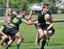 Gordon Anderson/Daily-Herald Tribune Grande Prairie Centaurs player Joshua Hoekstra breaks through the Leprechaun Tigers line during Edmonton Rugby Union play at Macklin Field on Saturday afternoon. The home side dropped a 38-7 decision to the visiting Tigers RFC.