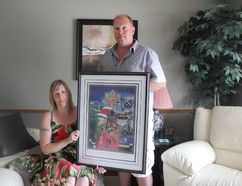 Tara Hill and Bill Shepherd, Larry's children, hold a drawing of their father done out of a picture of him at the historic Wolseley Barracks on Oxford Street in London. JONATHAN JUHA/THE BEACON HERALD/POSTMEDIA NETWORK