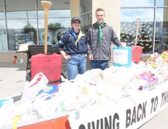 KASSIDY CHRISTENSEN HIGH RIVER TIMES/POSTMEDIA NETWORK. Sami Young, left, and Ethan Sawatzky, right, were the two Venturer Scouts who collected food and funds for the food bank.