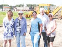 Jennifer Handley, left, Elisabeth Clarke, Crystal Caradonna, Dirk deGraaf and Karen Skalski stand in front of the lot where the new building for the Nanton Animal Protection Centre is currently under construction and will hopefully be done by late October or early November.