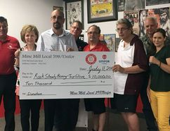 Representatives of Mine Mill Local 598/Unifor present a cheque to Top Glove Boxing Academy for the establishment of a local Rock Steady Boxing program, developed for people with Parkinson's disease, during a ceremony at Top Glove last week. Photo supplied