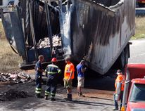 The remains of a tractor-trailer that was carrying freezies after it was engulfed in flames on the eastbound lane of Highway 401 just before the County Road 2 overpass west of Brockville. (MARSHALL HEALEY/Special to The Recorder and Times)
