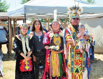 Photo by LESLIE KNIBBS/FOR THE STANDARD The Solomon family at the Sagamok Powwow. Nyssa, Acadia, mother Pamela, and father Jason Solomon holding baby Tomson wearing his regalia at his first powwow.