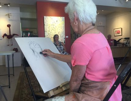 DAVE VACHON/THE INTELLIGENCER Gallery 121 member Marie Timbers (left) sketches an image of Paula Sara, Thursday afternoon, at the Belleville gallery during the 2018 Downtown Belleville Art Walk. The walk encompassed a number of Belleville galleries on Bridge and Front streets. This was the second walk held this summer.