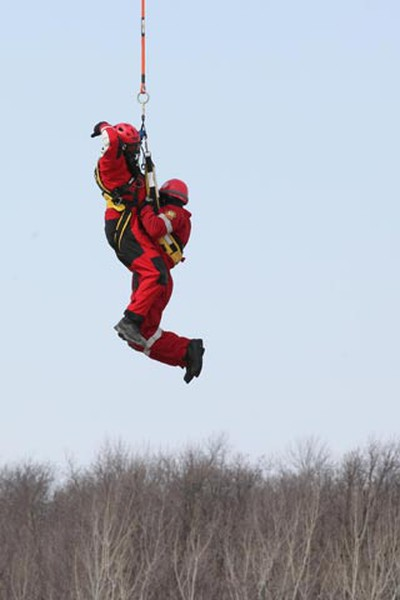 Members of the Office of the Fire Commissioner aerial rescue team demonstrate their capabilities near the floodway gates in Winnipeg on Wednesday, March 30, 2011. They will be on standby this spring as a precaution during the anticipated flood. (MARCEL CRETAIN/Winnipeg Sun)