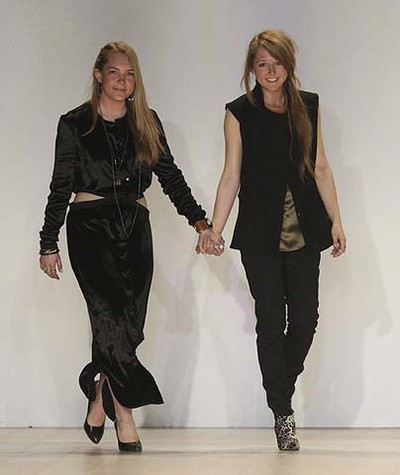 Desigers Chloé and Parris Gordon walk out to greet the crowd after showing the Chloe comme Parris fall winter 2011 collection during Toronto Fashion Week, Mar. 29, 2011. (Stan Behal/QMI Agency)