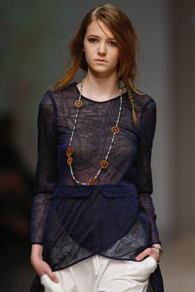 Trend of the week: Skirts, dresses, and shirts that start high in front and lengthen dramatically in back, like this Chloe commes Parris blouse. (Jack Boland/QMI Agency)