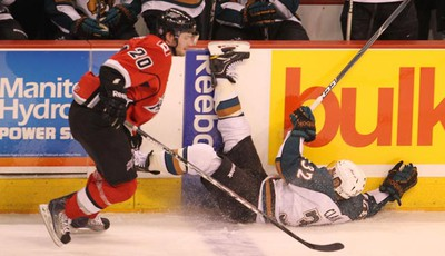 Manitoba Moose player Kevin Clark (right) gets hit by Heat player MacGregor Sharp during AHL action between the Abbotsford Heat and the Manitoba Moose at the MTS Centre Sunday, March 27, 2011. (MARCEL CRETAIN/Winnipeg Sun)