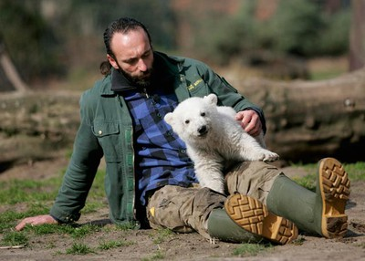 File photo of Berlin zoo employee Thomas Doerflein playing with polar bear cub Knut during the bear's first presentation in Berlin zoo, March 23, 2007. Knut, the polar bear who became a global celebrity as a cute cub, died in Berlin zoo March 19, 2011 aged just four. REUTERS/Hannibal Hanschke/Files