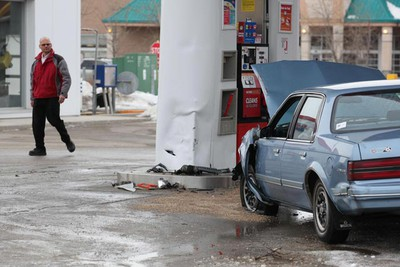 An older model Buick came to rest at a Petro-Canada Station after damaging a building, two vehicles and a gas pump at the intersection of Nathaniel Street and Grant Avenue March 16, 2011. One person was taken to hospital in unknown condition. (MARCEL CRETAIN/Winnipeg Sun)
