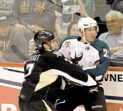 Wilkes-Barre/Scranton Penguins defenceman Brian Strait (left) takes out Manitoba Moose winger Shawn Weller at MTS Centre  Tuesday, March 15, 2011. (BRIAN DONOGH/Winnipeg Sun)
