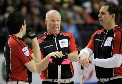 Ontario skip Glenn Howard reacts with teammates Craig Savill (left) and Richard Hart (right) after a shot against Manitoba during the final game at the Brier curling championships in London, Ontario, March 13, 2011. (MARK BLINCH/REUTERS)