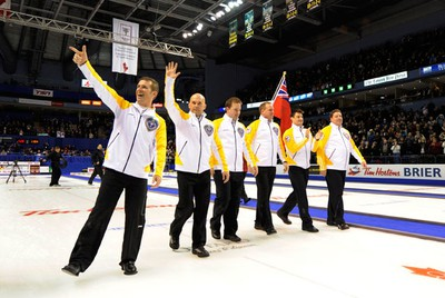 From left to righ Manitoba skip Jeff Stoughton, third Jon Mead, second Reid Carruthers, lead Steve Gould, alternate Garth Smith and coach Norm Gould celebrate after defeating Onatrio during the final game at the Brier curling championships in London, Ontario, March 13, 2011. (MARK BLINCH/REUTERS)