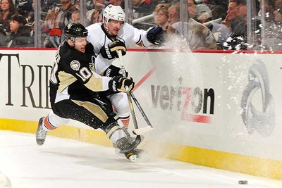 Mark Letestu #10 of the Pittsburgh Penguins checks Ladislav Smid #5 of the Edmonton Oilers as they race to a loose puck on March 13, 2011 at CONSOL Energy Center in Pittsburgh, Pennsylvania.  (Jamie Sabau/Getty Images/AFP0