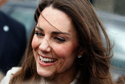 Kate Middleton, the fiancee of Britain's Prince William smiles as she leaves Hillsborough Castle in Northern Ireland March 8, 2011. Cheering crowds and armed police greeted Prince William as he flew into Northern Ireland on Tuesday to show off his bride-to-be Kate Middleton. (REUTERS/Cathal McNaughton)