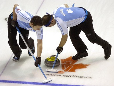 Quebec second Christian Bouchard, left, and lead Philippe Menard sweep during a second draw game against Manitoba on day six at the 2011 Tim Hortons Brier Canadian Men's Curling Championships played at the John Labatt Centre in London on Thursday, March 10, 2011. (MORRIS LAMONT/QMI AGENCY)