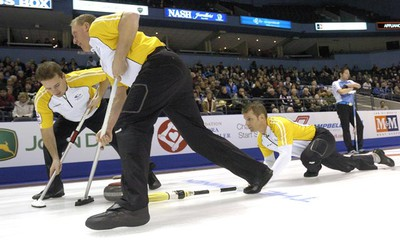 Manitoba second Reid Carruthers, left, and lead Steve Gould in front of skip Jeff Stoughton during a second draw game against Quebec on day six at the 2011 Tim Hortons Brier Canadian Men's Curling Championships played at the John Labatt Centre in London on Thursday, March 10, 2011. (MORRIS LAMONT/QMI AGENCY)
