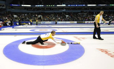 Manitoba skip Jeff Soughton delivers a rock against Quebec during the 13th draw at the Brier curling championships in London, Ontario March 10, 2011. (Mark Blinch/REUTERS)