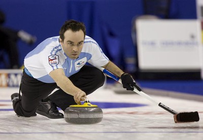 Quebec skip Francois Gagne releases a rock during a game against Newfoundland and Labrador at The Brier in London, Ontario on Thursday, March 10, 2011. (DEREK RUTTAN/QMI AGENCY)