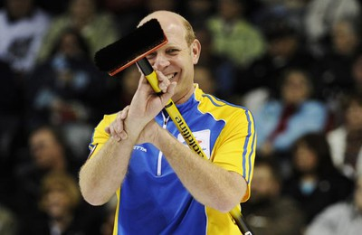 Alberta skip Kevin Martin smiles during a break in play against Northwest Territories/Yukon during the 13th draw at the Brier curling championships in London, Ontario, March 10, 2011. (Mark Blinch/REUTERS)