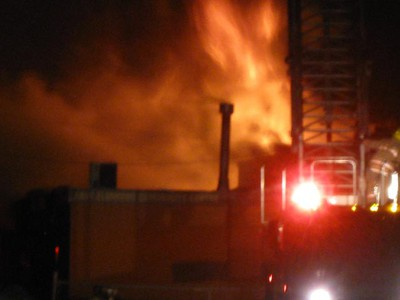 Flames are spotted in the dark early Wednesday, March 9, 2011 at the East Elmwood Community Centre, which was gutted by fire. The blaze began around 4:30 a.m. at the Beach Avenue building, which houses a daycare that serves about 40 children. Nearby Kent Road School was also closed while emergency crews battled the blaze. No serious injuries were reported. (Winnipeg Sun Reader)