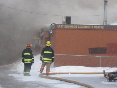 Firefighters survey the blaze at the East Elmwood Community Centre March 9, 2011. Flames gutted the centre and smoke could be seen from blocks away. (Winnipeg Sun Reader)