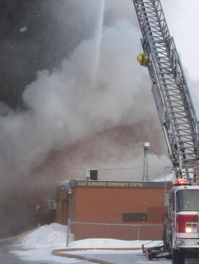 Thick plumes of smoke billow early Wednesday, March 9, 2011 at the East Elmwood Community Centre, which was gutted by fire. (Winnipeg Sun Reader)