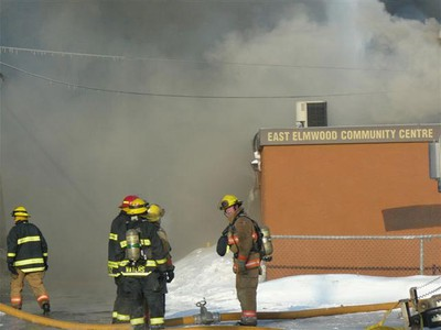 Firefighters work to battle a blaze early Wednesday, March 9, 2011 at the East Elmwood Community Centre, which was gutted by fire. No serious injuries were reported. (BILL JOHNSTON/For The Winnipeg Sun)
