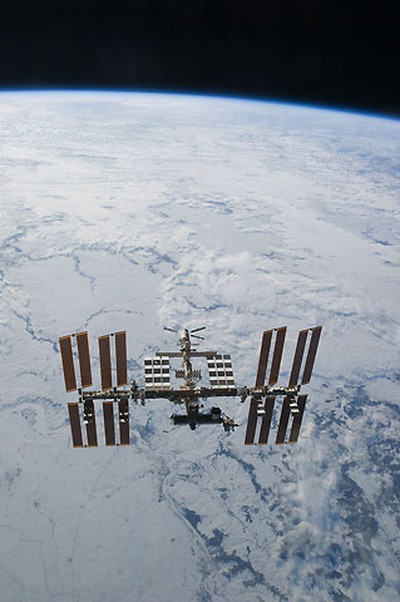 The International Space Station is seen in this view from the space shuttle Discovery with the earth's horizon in the background after the undocking of the two spacecraft in this photo provided by NASA and taken March 7, 2011. REUTERS/NASA/Handout