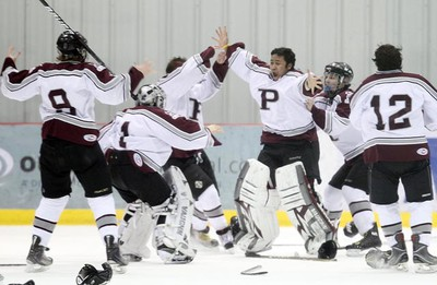 St. Paul's Crusaders goalie Mikey Rodgers (centre) celebrates with teammates after defeating the Oak Park Raiders 5-0 in the WHSHL final on March 7, 2011. (BRIAN DONOGH/Winnipeg Sun)