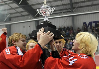 Shaftesbury Titans Andrew Courtney (left) and Steve Robillard hoist the trophy after defeating Garden City Gophers 4-1 in the WHSHL bronze game on March 7, 2011. (BRIAN DONOGH/Winnipeg Sun)