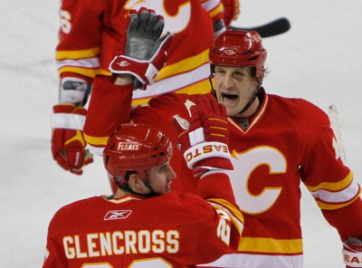 Tim Jackman gives Curtis Glencross a big high five as they celebrate their 3-2 victory over the Nashviille Predators at the Scotiabank Saddledome, Sunday March 6 2011, Calgary Alberta. Photo special to the Sun/QMI Agency by James MacKenzie