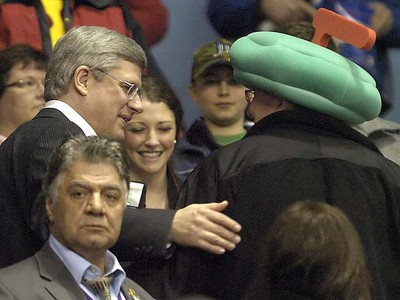 Prime Minister Stephen Harper has his photo taken with fans prior to the start of the afternoon draw on opening day. MORRIS LAMONT / THE LONDON FREE PRESS / QMI AGENCY