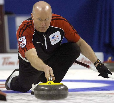 Ontario skip Glenn Howard throws his last rock in the 10th end during a 5-4 loss to James Gratten's New Bruinswick team on opening day at the 2011 Tim Horton's Brier. MORRIS LAMONT / THE LONDON FREE PRESS / QMI AGENCY