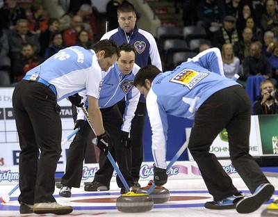 Quebec skip Francois Gagne shouts instructions to teammates Robert Desjardins, left, and Christian Bouchard as Nova Scotia skip Shawn Adams watches during a second draw game against Nova Scotia MORRIS LAMONT / THE LONDON FREE PRESS / QMI AGENCY