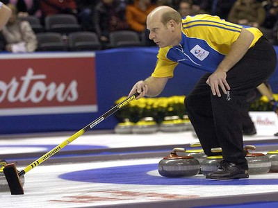 Alberta skip Kevin Martin marks the spot during a second draw game against Northern Ontario on opening day at the 2011 Tim Horton's Brier at the John Labatt Centre  MORRIS LAMONT / THE LONDON FREE PRESS / QMI AGENCY
