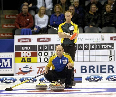 Northern Ontario skip Brad Jacobs watches as Alberta skip Kevin Martin lines up his shot during a second draw game on opening day at the 2011 Tim Horton's Brier at the John Labatt Centre  MORRIS LAMONT / THE LONDON FREE PRESS / QMI AGENCY