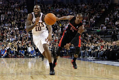 New Jersey Nets forward Damion James (L) and Toronto Raptors guard Leandro Barbosa chase the ball in the second quarter of their NBA game in London on March 5, 2011. (REUTERS)